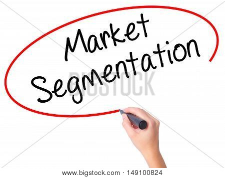 Women Hand Writing Market Segmentation With Black Marker On Visual Screen.