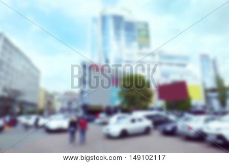 Blurred background: city street with tall building