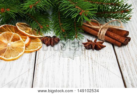 baking concept - spices for christmas cookie and green pine tree