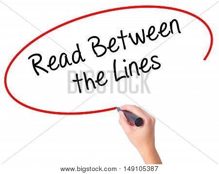 Women Hand Writing Read Between The Lines   With Black Marker On Visual Screen
