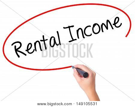 Women Hand Writing Rental Income With Black Marker On Visual Screen.