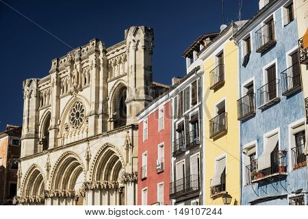 Cuenca (Castilla-La Mancha Spain) facade of the medieval cathedral in gothic style and colorful houses