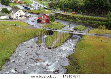 NORHEIMSUND, NORWAY - JULY 2, 2016: This is a small settlement under the waterfall Steinsdalsfossen.