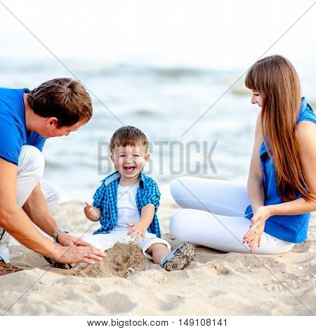 Family resting on the sea and have fun on a bright sunny day