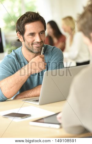 Businessman in office meeting with client
