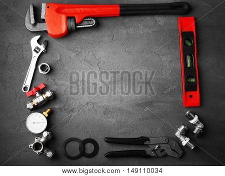 Plumber tools frame on concrete structure background