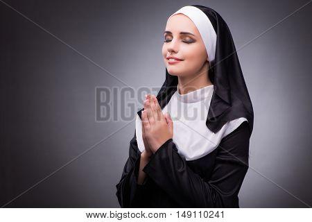 Religious nun in religion concept against dark background