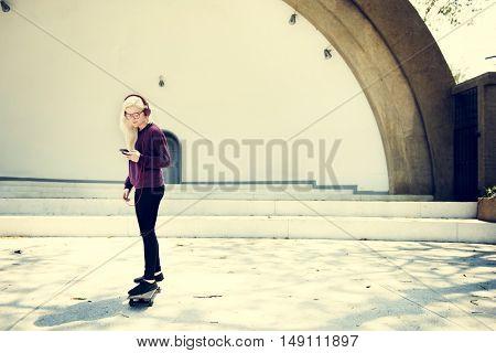 Young Girl Skateboad Outdoors Urban Concept