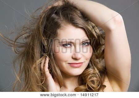 Young Woman Playing With Hairs