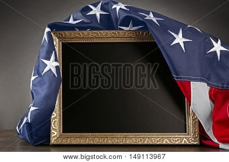 American flag and blank frame on grey background