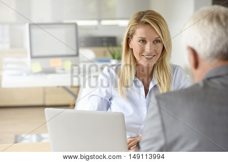 Human resources manager receiving candidate for job