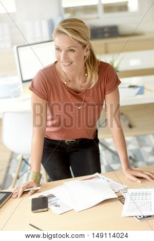 Executive middle-aged woman standing in office