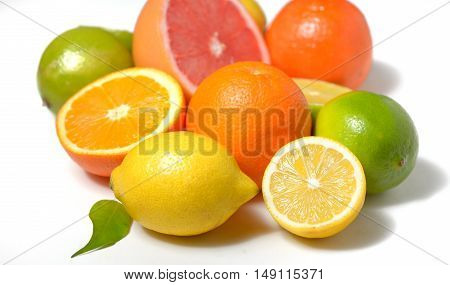citrus fruit with leaves on white background