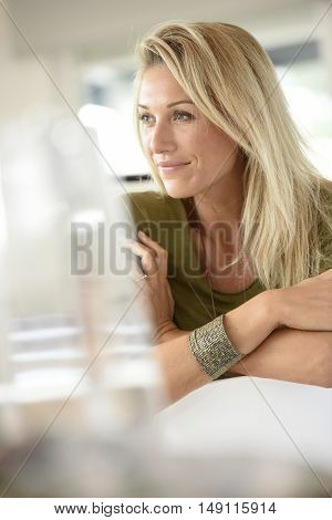 Portrait of beautiful blond woman in office