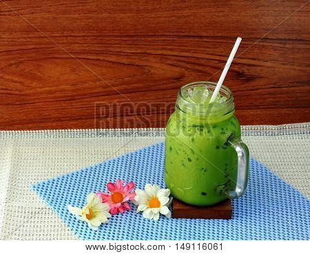 ice green tea on table and wood background