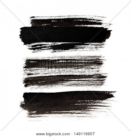 Set of expressive black brush strokes isolated over the white background