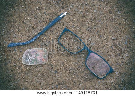 glasses crushed on the ground, broken glasses