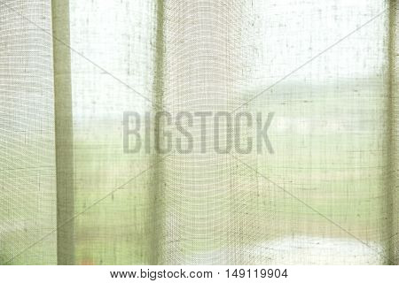 close up of a translucent mesh screen curtain background.