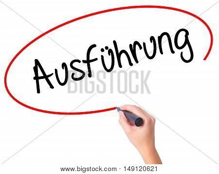 Women Hand Writing Ausfuhrung (execution In German) With Black Marker On Visual Screen