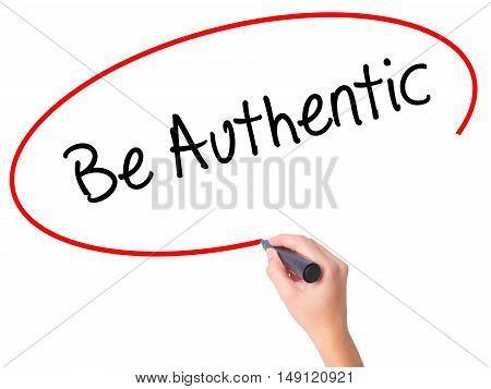 Women Hand Writing Be Authentic With Black Marker On Visual Screen