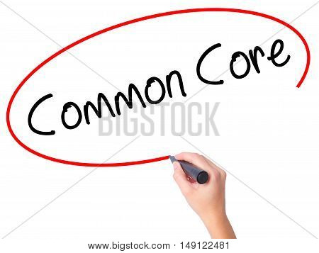 Women Hand Writing Common Core With Black Marker On Visual Screen