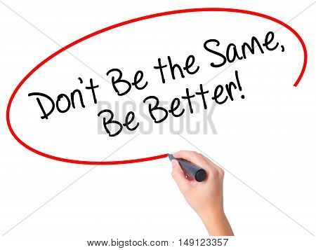 Women Hand Writing Don't Be The Same, Be Better! With Black Marker On Visual Screen