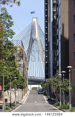 The tower of Anzac Bridge at the end of little street (New South Wales).
