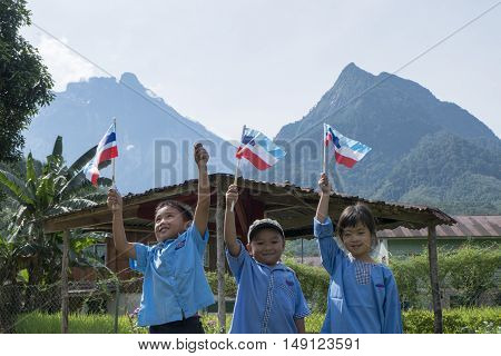 TAMBATUON,KOTA BELUD SABAH,AUGUST 2016:A group of kindergarten students who were making a photo session with the flags of Malaysia and Sabah for the Malaysian Independence Day.