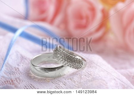 Two wedding rings on a cushion
