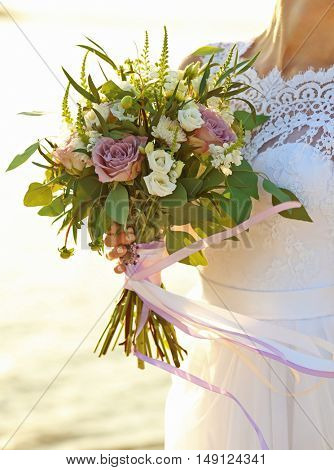 Bride with beautiful bouquet, outdoor
