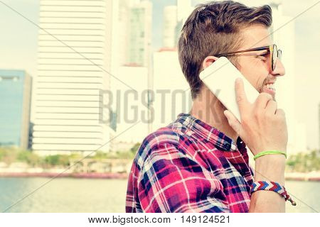 Young Man Outdoors Talking Smart phone Concept