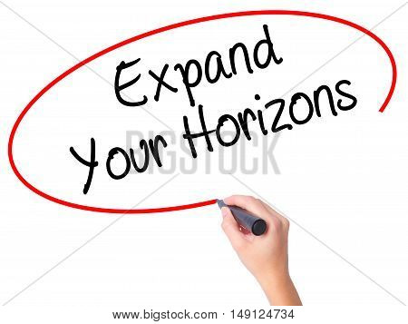 Women Hand Writing  Expand Your Horizons  With Black Marker On Visual Screen