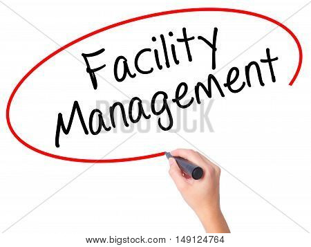 Women Hand Writing Facility Management With Black Marker On Visual Screen