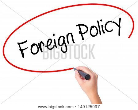 Women Hand Writing Foreign Policy With Black Marker On Visual Screen