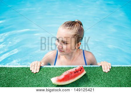 Beautiful Young Girl Relaxing In The Swimming Pool