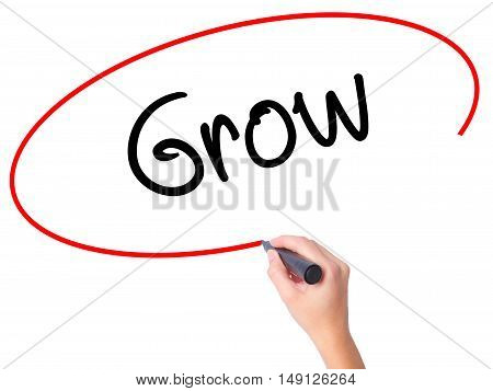 Women Hand Writing  Grow With Black Marker On Visual Screen