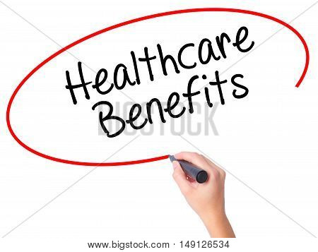 Women Hand Writing Healthcare Benefits With Black Marker On Visual Screen