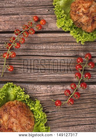 Delicious baked cutlets over wooden surface with copy space for your text