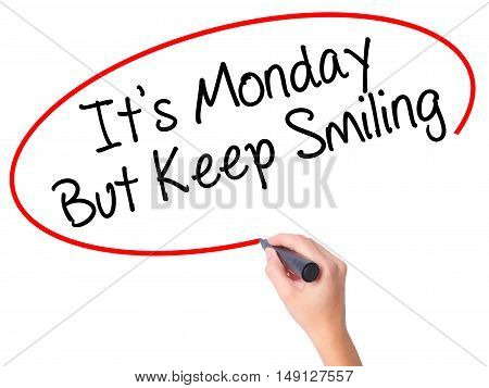 Women Hand Writing It's Monday But Keep Smiling With Black Marker On Visual Screen