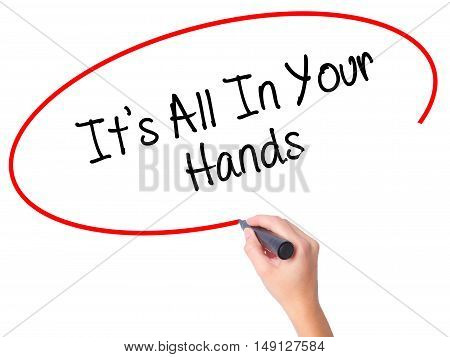 Women Hand Writing It's All In Your Hands  With Black Marker On Visual Screen.