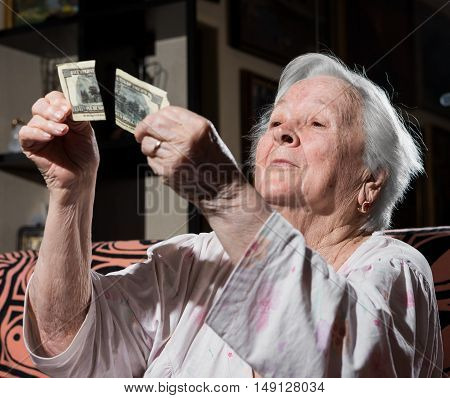Woman Looking At Torn One Hundred Dollar Bill