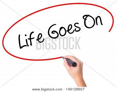 Women Hand Writing Life Goes On With Black Marker On Visual Screen