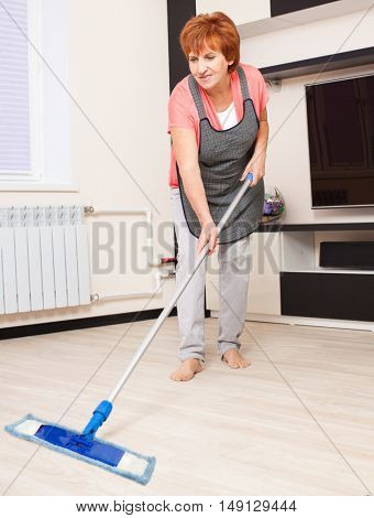 Woman cleaning the floor at home. Housework