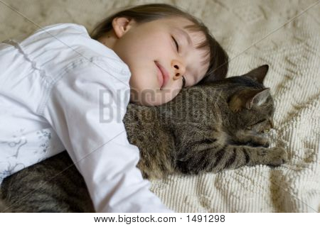 Girl Hugging Her Cat