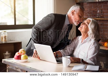 Love. Attractive white male going to leave to work while smiley female staying home with her laptop