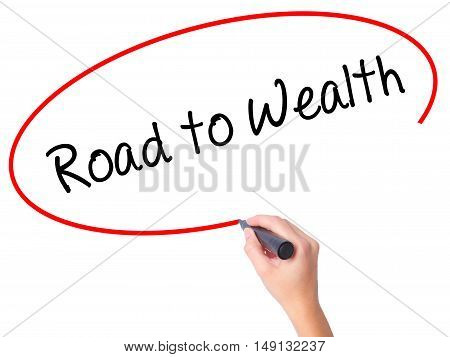 Women Hand Writing Road To Wealth With Black Marker On Visual Screen