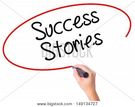 Women Hand Writing Success Stories With Black Marker On Visual Screen
