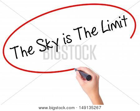 Women Hand Writing The Sky Is The Limit  With Black Marker On Visual Screen