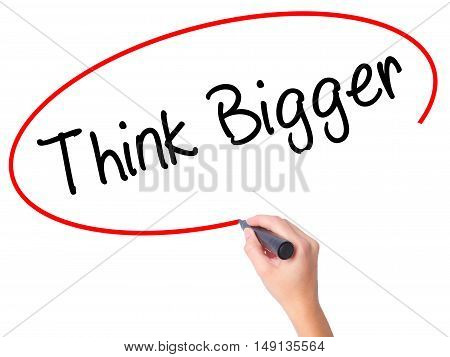 Women Hand Writing Think Bigger With Black Marker On Visual Screen.