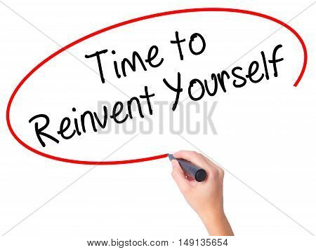 Women Hand Writing Time To Reinvent Yourself With Black Marker On Visual Screen